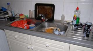 Neglect couple's kitchen