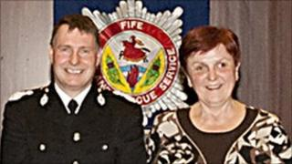 Chief Fire Officer Neil McFarlane and Eva Pollokova