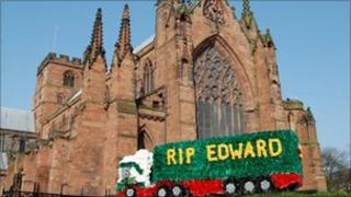 One of the many floral tributes in memory of Edward Stobart outside Carlisle cathedral