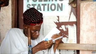 An elderly Nigerian man casts his ballot in the Ketu district of Lagos. Photo by Pius Utomi Ekpei/AFP/Getty Images