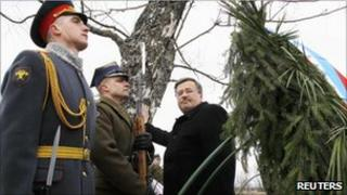 Poland's President Bronislaw Komorowski takes part in a commemoration ceremony at the site of a plane crash that killed former President Lech Kaczynski and 95 others, near Smolensk, 11 April 2011
