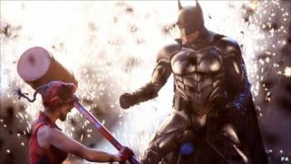 Batman (r) with Harley Quinn in Batman Live