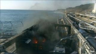 A small fire breaks out from facilities sampling seawater at the crippled Fukushima Daiichi nuclear power plant, 12 April.