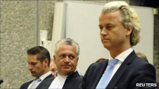 Geert Wilders (R) and his lawyer Bram Moszkowicz (C) in court in Amsterdam on 13 April 2011