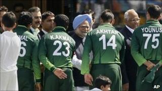 Indian Prime Minister Manmohan Singh, centre back, and Pakistan Prime Minister Yousuf Raza Gilani, fourth from left at back, shake hands with Pakistan players ahead of the Cricket World Cup semi-final match between India and Pakistan in Mohali, India, on March 30, 2011.
