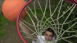 Boy playing basket ball