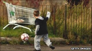 Child playing football (generic)