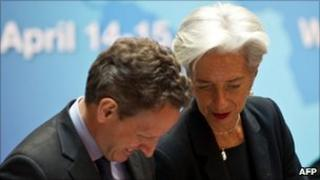 French Finance Minister and G20 chair Christine Lagarde speaks to US Treasury Secretary Tim Geithner