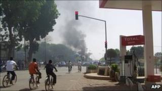 Smoke billows over Ouagadougou after traders riot in the Burkina Faso capital, 16 April