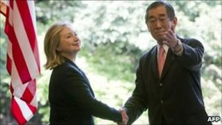 Japanese Foreign Minister Takeaki Matsumoto (right) shakes hands with US Secretary of State Hillary Clinton in Tokyo on 17 April 2011