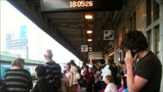 Passengers wait for delayed trains at Cardiff Central