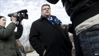 Timo Soini speaks to reporters after voting in Espoo, Helsinki, 17 April