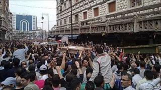 A mobile phone photo purporting to show the funeral for the people killed overnight in Homs (18 April 2011)