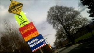 posters on lamppost