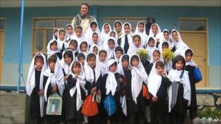This 2005 photo provided by the Central Asia Institute shows Greg Mortenson, standing with schoolgirls from the Lalander village school, Char Asiab valley, central Afghanistan.