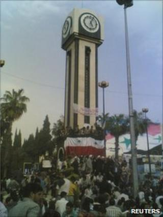 People gather at Clock Square in Homs, 18 April