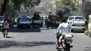 Yemeni security forces ride at the back of pick-up trucks during clashes with anti-regime demonstrators in Taiz, April 19 2011