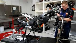Working on a bike at the HM Plant Honda in Louth
