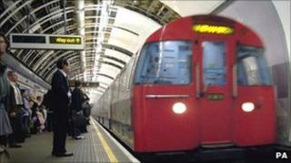 Passengers at a Tube station
