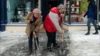 Shopkeepers clear snow