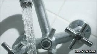 Water pouring from tap
