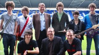 RetroGrade pose with Sir John Madejski (top centre) at the Reading stadium