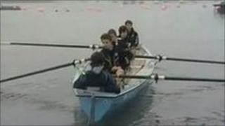 The five boys rowing