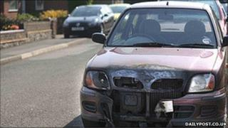 A car targeted in the latest arson attacks in Wrexham (picture: dailypost.co.uk)