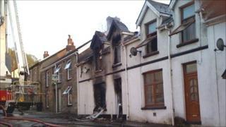 Fire-damaged house in Merthyr Road, Glynneath
