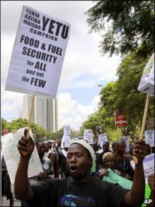 Kenyan protesters hold placards during a demonstration against food and fuel prices rises in Nairobi, Kenya