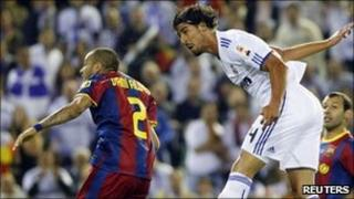 "Real Madrid's Sami Khedira (R) fights for the ball with Barcelona""s Dani Alves"