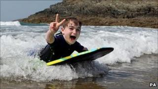 Sam Davies plays in the sea at Whitesands in Pembrokeshire in Wales