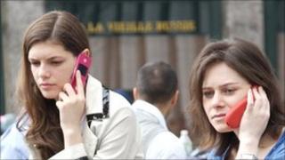 Women on mobiles