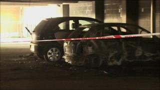 Two cars were set on fire in the car park on Thursday morning