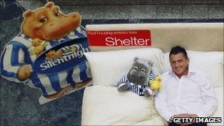 England cricketer Darren Gough posing on a bed in a promotion for Silentnight