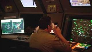Air traffic controller drinks coffee in control tower in Peachtree City, Georgia, US