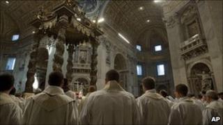 Roman Catholic clergy attend a papal Mass in St Peter's Basilica, Vatican City, 21 April