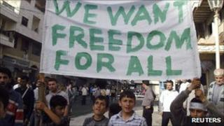 Boys hold a banner during a demonstration in the Syrian port city of Baniyas on 17 April 2011