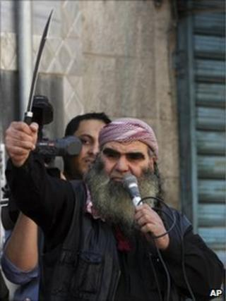 A Salafist protester holds a sword during a demonstration in Zarqa, east of Amman, 15 April