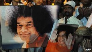 Devotees praying for Sai Baba's recovery