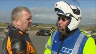 North Wales Police bike patrol officer speaks to motorcyclist