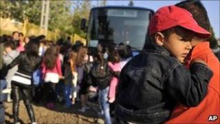 Roma women and children leave Gyongyospata, Hungary (22 April 2011)