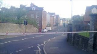 Police tape across road