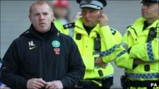 Neil Lennon and police at Celtic match
