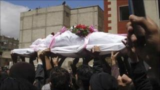 In this citizen journalism image made on a mobile phone, Syrian protesters carry the coffin of an activist in Quaboun near Damascus, Syria, 23 April 2011.