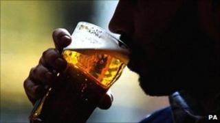 Man drinking lager