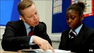 Education Secretary Michael Gove speaks to pupil at Pimlico Academy