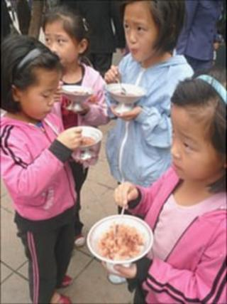 North Korean children eating