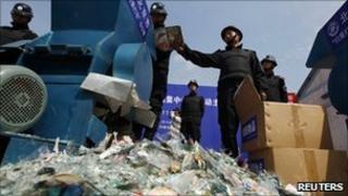 Counterfeit DVDs being destroyed