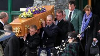 David and Katie Taylor follow the coffin of their daughter Sophie from the Lecht Ski centre where her funeral was held.